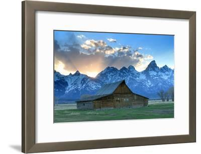 At Sunset, the Teton Range Rises Behind a Historic Barn on Mormon Row
