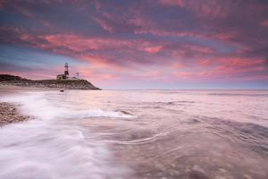 Beautiful Evening Clouds Swirl around Montauk Point Lighthouse by Robbie George