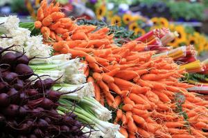 Colorful Organically Farmed Vegetables Displayed for Sale at the Maine Organic Farmers' Market by Robbie George