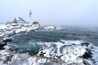 Maine's Portland Head Light Is Festively Decorated on a Cold and Foggy Winter's Day by Robbie George