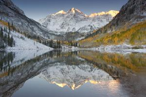Reflections of Snow-covered Mountains and Golden Aspen Trees in a Lake by Robbie George