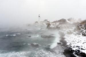 Sea Smoke Rises Up around Maine's Portland Head Light on a Cold Winter's Day by Robbie George