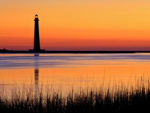 Silhouetted Morris Island Lighthouse at Sunrise by Robbie George