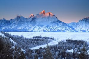 Snowy Peaks in Grand Teton National Park Reflect Sunset Colors by Robbie George