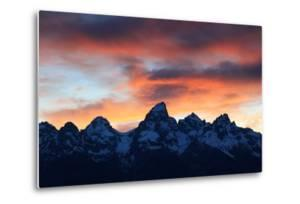 Snowy Peaks in the Teton Range Outlined by an Orange Sky at Sunset by Robbie George
