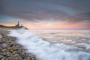 Waves Wash over Cobbles in Front of Montauk Point Lighthouse by Robbie George