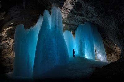 A Caver Is Dwarfed by the Scale of the Ice Formations in Eiskogelhoehle in the Austrian Alps