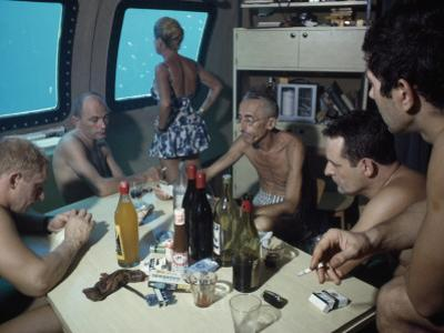 The Cousteaus and their Crew Relax in a Submersible after Work by Robert B^ Goodman