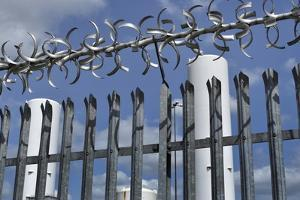 Security Fence by Robert Brook