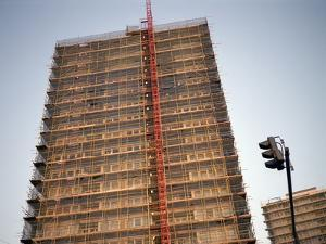 Tower Block Covered in Scaffolding by Robert Brook