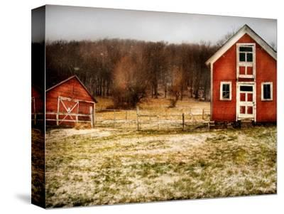 Red Farmhouse and Barn in Snowy Field