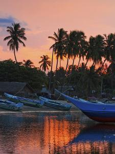 Boats and Palm Trees at Sunset at This Fishing Beach and Popular Tourist Surf Spot, Arugam Bay, Eas by Robert Francis