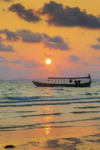 Fishing boat moored off beach south of the city at sunset, Otres Beach, Sihanoukville, Cambodia by Robert Francis