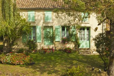 House with typical regional green shutters in the Marais Poitevin (Green Venice) wetlands, Arcais,