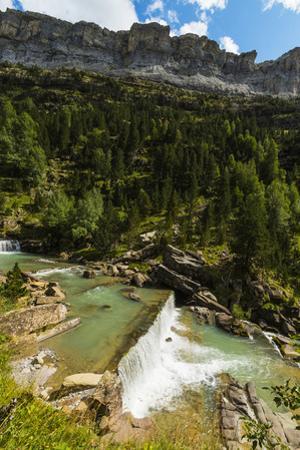 Sierra de las Cutas on the south rim above a Rio Arazas waterfall, Ordesa Valley, Ordesa National P