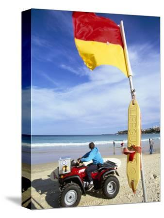Swimming Flag and Patrolling Lifeguard at Bondi Beach, Sydney, New South Wales, Australia