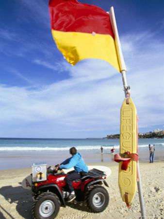 Swimming Flag and Patrolling Lifeguard at Bondi Beach, Sydney, New South Wales, Australia by Robert Francis