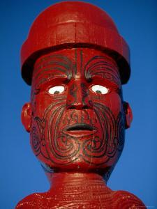 Traditional Maori 'Poupou' Figure, Whakarewarewa Village, Rotorua, New Zealand by Robert Francis