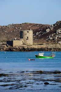 Fishing Boat, Cromwell's Castle on Tresco, Isles of Scilly, England, United Kingdom, Europe by Robert Harding
