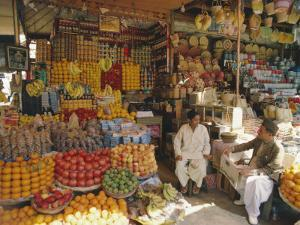 Fruit and Basketware Stalls in the Market, Karachi, Pakistan by Robert Harding