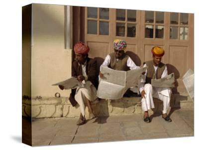 Men Reading Newspapers, Meherangarh Fort, Jodphur, Rajasthan, India