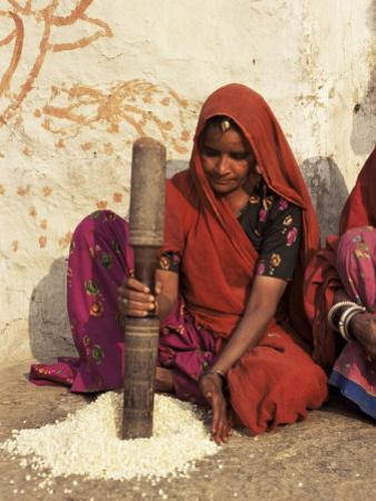 Woman Pounding Food in Village Near Deogarh, Rajasthan State, India by Robert Harding