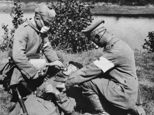 German Medics Using an Oxygen Machine on the Western Front During World War I by Robert Hunt