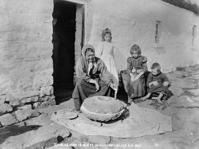 Grinding Grain in a Quern, Inishmurray, County Sligo, 1900