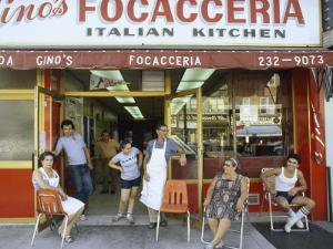 A Family Sits Outside Gino Pollari's Italian Restaurant in Brooklyn by Robert Madden