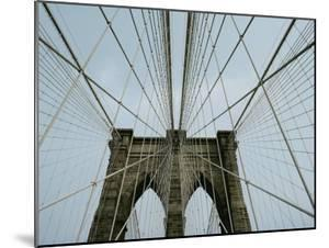 Cables Form an Abstract Web Around the Points of Two of the Bridges Archways by Robert Madden