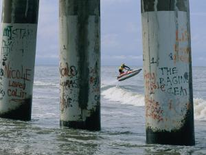 Graffiti-Covered Pilings by Robert Madden