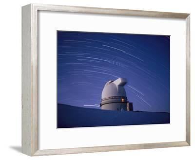 Time-Exposure of the Mauna Kea Observatory Taken at Night, the Streaks in the Sky are Star Trails
