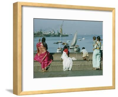 Indian People Look out over the Harbor in Bombay