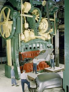 Men Work at Machine That Presses Car Hoods from Flat Steel Sheets by Robert Sisson