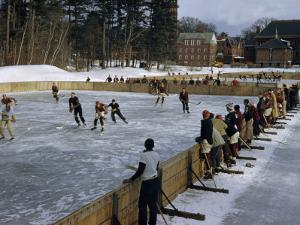 Students Play Ice Hockey on Frozen Pond on Private School's Campus by Robert Sisson