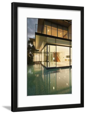 Lit House with Reflections in Water of Residential House, Sentosa Island, Singapore South East Asia