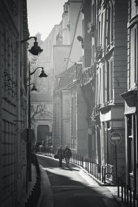 Two People Walking Up Sunny Side Street Near St Michel Notre Dame in Paris, France by Robert Such