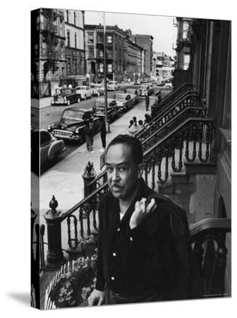African American Poet/Writer Langston Hughes Standing on the Stoop in Front of His House in Harlem