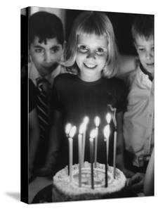 Little Girl Blowing Out Her Candles on Her Birthday Cake by Robert W. Kelley