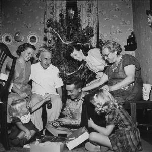 Prisoner of War Home from a Korean Prison Camp Celebrating Christmas in August with His Family by Robert W. Kelley