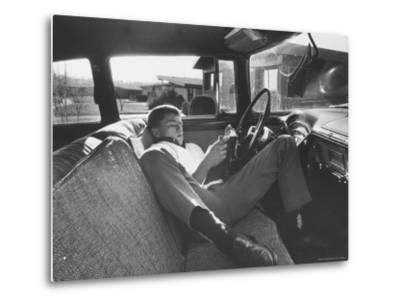 Teenager Robert Riesenmy Jr. Reading in Car at Home