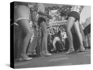 Teenagers in a Record Shop Watch 13 Year Old Steve Shad Imitate Moves of Rock Star Elvis Presley by Robert W. Kelley