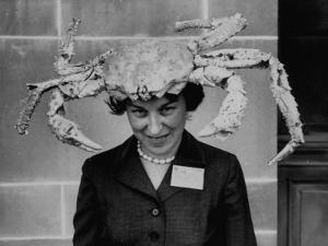 Woman Wearing a Crab Hat at the League of Women Voter's Convention by Robert W^ Kelley