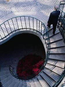 Businessman Ascending Stairs at Embarcadero Centre, San Francisco, California, USA by Roberto Gerometta