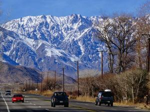 Highway 395 in Inyo County with the Eastern Sierras in Background, California, USA by Roberto Gerometta