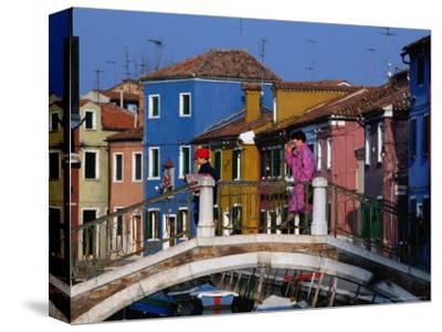 People Crossing Bridge Over a Canal, Burano, Veneto, Italy