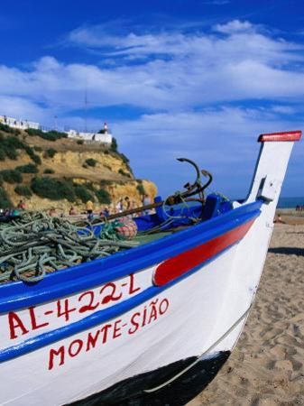 Traditional Painted Fishing Boat on Beach, Albufeira, Algarve, Portugal,