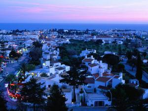 View Over the Town at Dusk, Albufeira, Algarve, Portugal, by Roberto Gerometta
