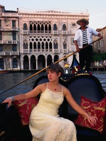 Woman in Gondola in Front of Ca'D'Oro in Grand Canal, Venice, Veneto, Italy