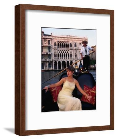Woman in Gondola in Front of Ca'D'Oro in Grand Canal, Venice, Veneto, Italy
